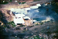Smoldering ruins of Branch Davidian compound where 76 people died.